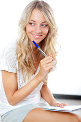 blonde woman with pen and notepad