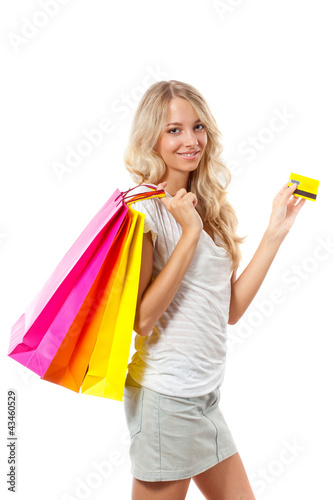 blonde woman holding card and bags