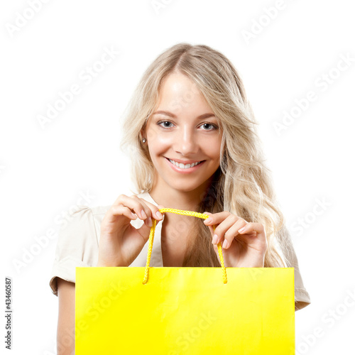 blonde woman holding yellow shopping bag