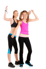 two young women doing zumba fitness