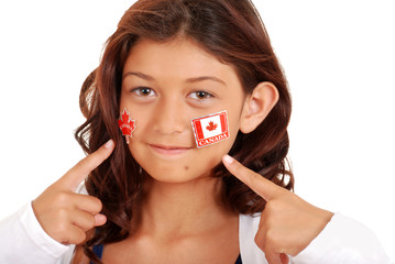 young girl with Canada day stickers on face