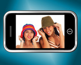 Two Teenage Girls In Hats Picture On Smartphone