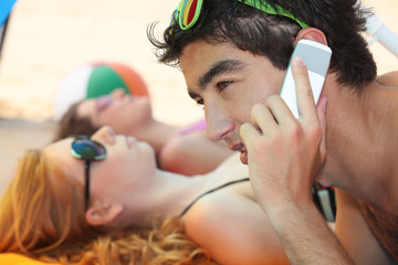 Telephoning from the beach