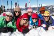 Two Family Having Fun On Ski Holiday In Mountains