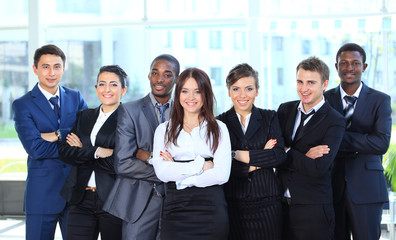 Happy young business woman with her team in