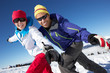 Couple Having Fun On Ski Holiday In Mountains