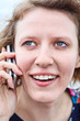 Surprised face of woman with mobile phone