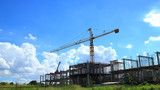 Building crane and building with sky and cloud running