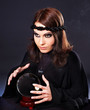 Woman with crystal ball.