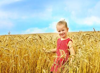Child in wheat field. .