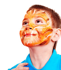 Child with paint of face.
