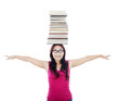 Student with stack of books on her head