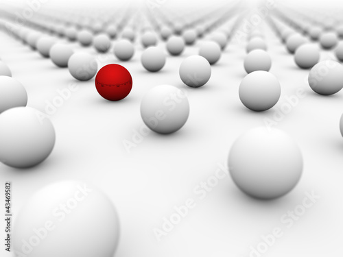 Red ball surrounded by white ones