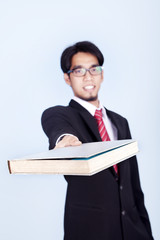 Businessman giving book