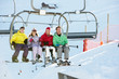 Teenage Family Getting Off chair Lift On Ski Holiday In Mountain
