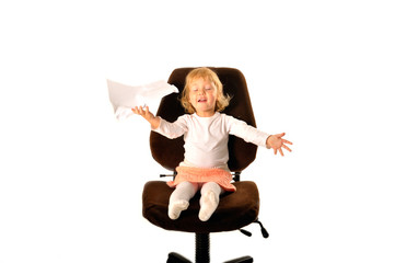 Pretty child with blank sitting on a chair. isolated on white