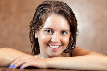 Beautiful woman in spa jacuzzi
