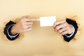 Hands and business card