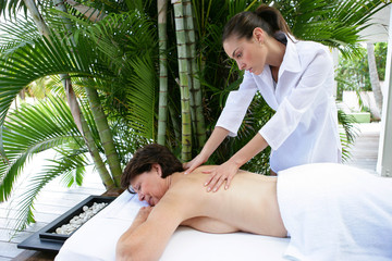 Woman receiving soothing back massage