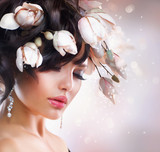 Fashion Brunette Girl with Magnolia. Hairstyle.
