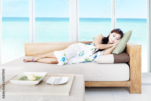 Woman taking a nap in living room