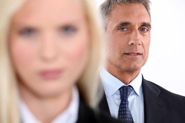 Male executive with female colleague out of focus
