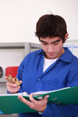 Young  person with piece of plumbing