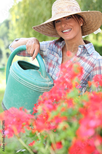 Brunette watering flowers