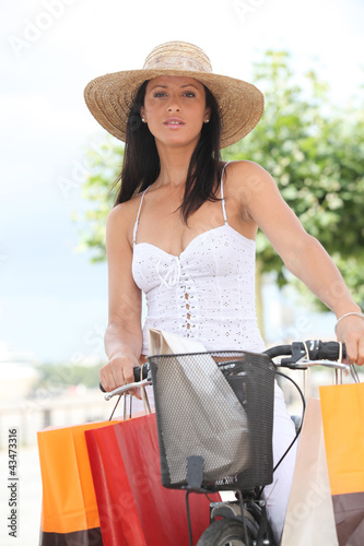 Brunette with push bike and shopping bags