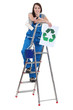 Female decorator holding recycle sign