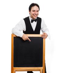 Waiter showing a blackboard