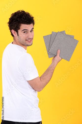 Man holding bathroom tiles