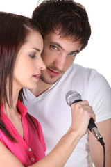 young man and woman singing together