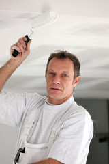 Decorator painting ceiling
