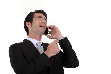 Businessman laughing during telephone call