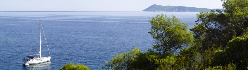 Motor yacht in mediterranean landscape