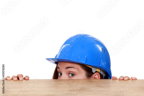 craftswoman hiding behind a table