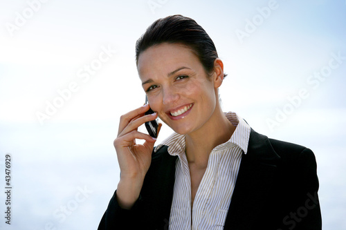 Businesswoman on the phone outdoors
