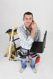 Handyman with a phone and laptop