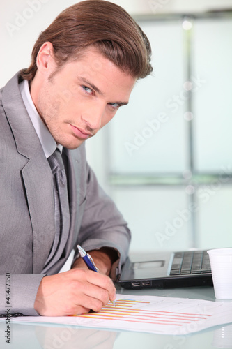 Young businessman analysing
