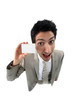young businessman holding business card playing the fool
