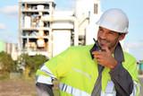 Site foreman communicating via radio receiver