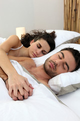 Couple asleep in bed