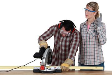 Couple with a circular saw