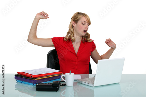 Tired woman sitting at a laptop