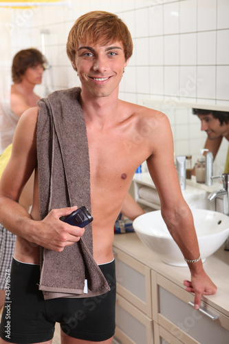 Young men in the bathroom with a razor