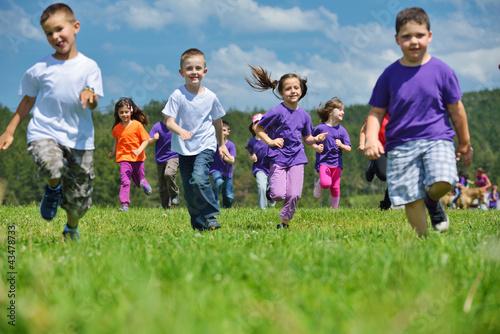Leinwanddruck Bild happy kids group  have fun in nature