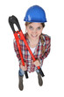 High-angle shot of a tradeswoman holding large clippers