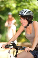 Girl on bicycle with helmet