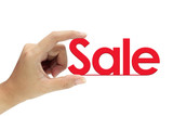 Hand holding sale sign isolated on white